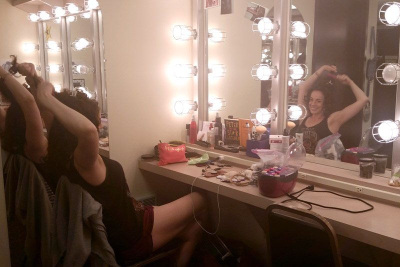 Lizzy prepares in the dressing room